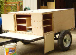 compact camping trailer build rear wing and cross support are added